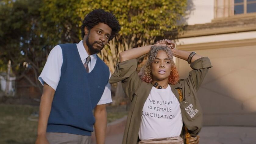 """Lakeith Stanfield and Tessa Thompson appear in """"Sorry to Bother You"""" movie by Boots Riley, an offici"""