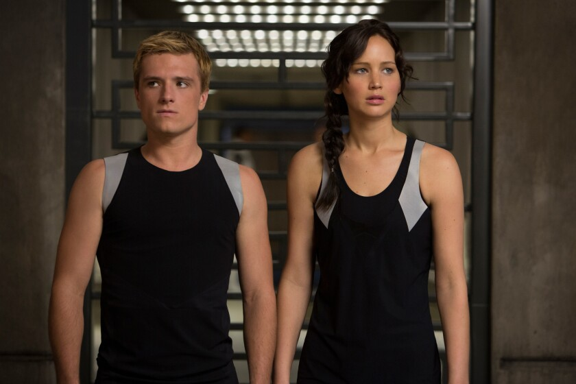 """Josh Hutcherson and Jennifer Lawrence star in Lions Gate Entertainment Corp.'s """"The Hunger Games: Catching Fire."""""""