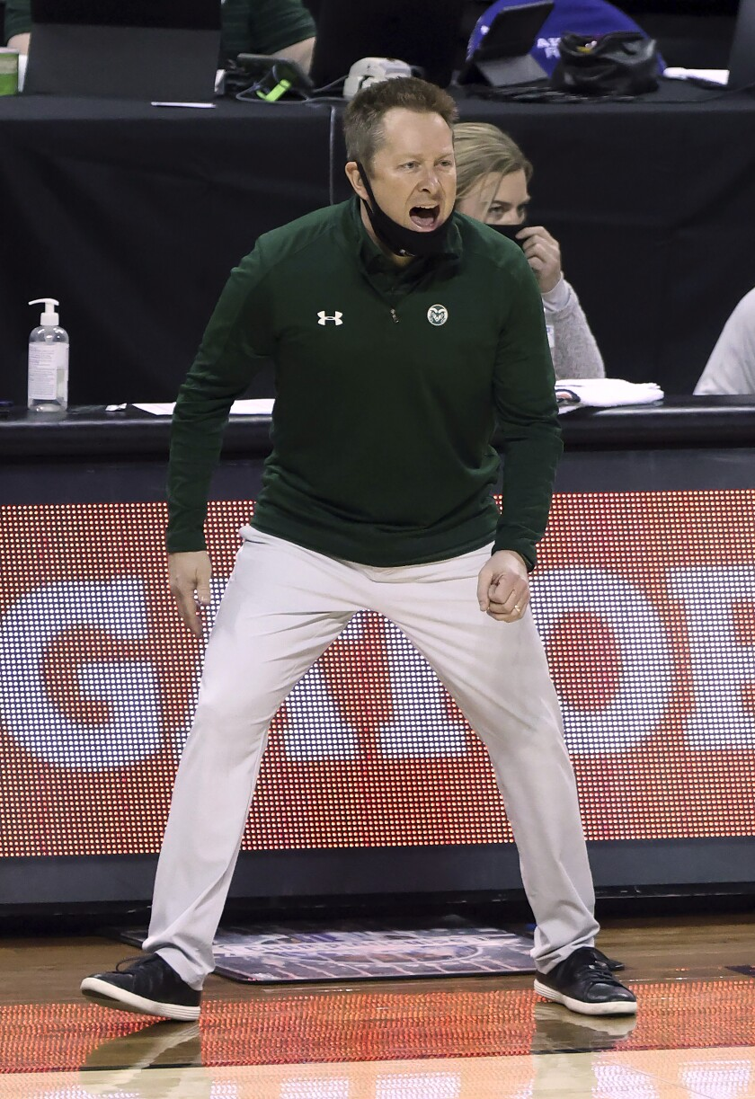 Colorado State head coach Niko Medved instructs his team during the first half of an NCAA college basketball game against Utah State in the semifinal round of the Mountain West Conference men's tournament Friday, March 12, 2021, in Las Vegas. (AP Photo/Isaac Brekken)
