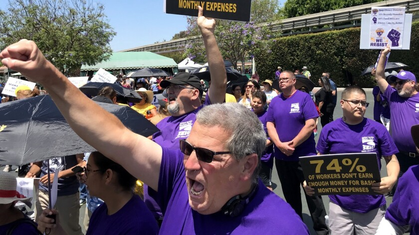 ANAHEIM, CALIF. -- TUESDAY, JULY 3, 2018: After a march into the entrance of the park, Disneyland cu