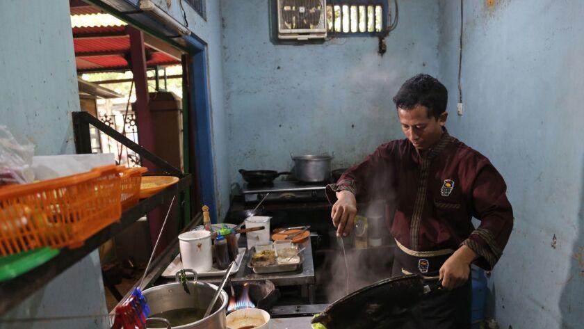 "Machmudi Hariono, who is also known by his militant alias ""Yusuf Adirama"" cooks in the kitchen of hi"