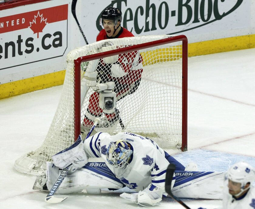 Ottawa Senators' Jean-Gabriel Pageau (44) celebrates an assist on a goal by teammate Mika Zibanejad, not shown, as Maple Leafs' goalie James Reimer (34) reacts during the first period of an NHL hockey game, Saturday, Feb. 6, 2016, in Ottawa, Ontario. (Fred Chartrand/The Canadian Press via AP) MANDA
