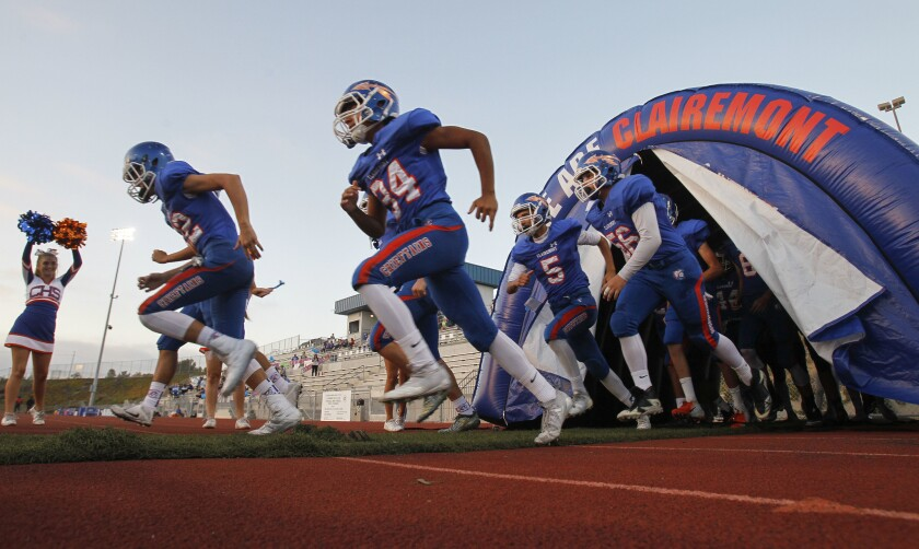 Clairemont High players run onto the field to play in September 2018.