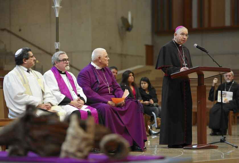 Archbishop Jose Gomez delivers remarks alongside members of the Los Angeles Council of Religious Leaders during an interfaith prayer service for immigration reform at the Cathedral of Our Lady of the Angels.