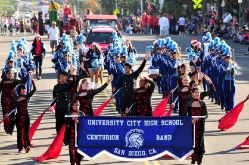A marching band contingent traverses down Girard Avenue during last year's La Jolla Christmas Parade. File