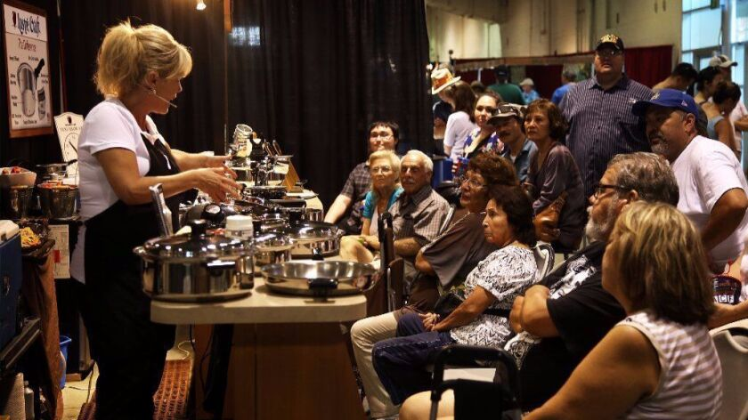 Fairgoers listen to a pitch for Lustre Craft cookware in 2015 at the Los Angeles County Fair in Pomo