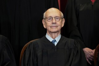 In this April 23, 2021, photo, Supreme Court Associate Justice Stephen Breyer sits during a group photo at the Supreme Court in Washington. (Erin Schaff/The New York Times via AP, Pool)