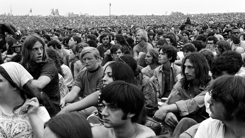 "An archival photograph during the Woodstock Festival featured in ""Woodstock: The Three Days That Def"