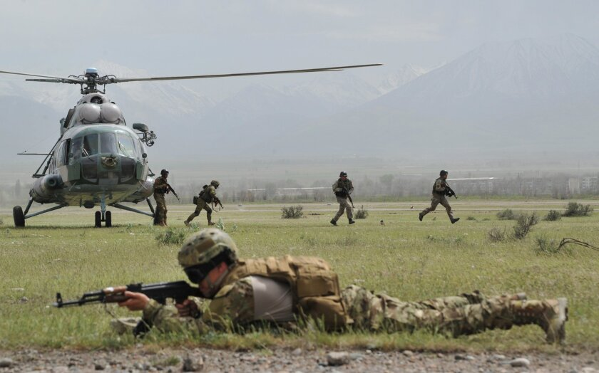 Special forces soldiers of the Shanghai Cooperation Organization, which includes Russia, deploy during military exercises last month in Kyrgyzstan.