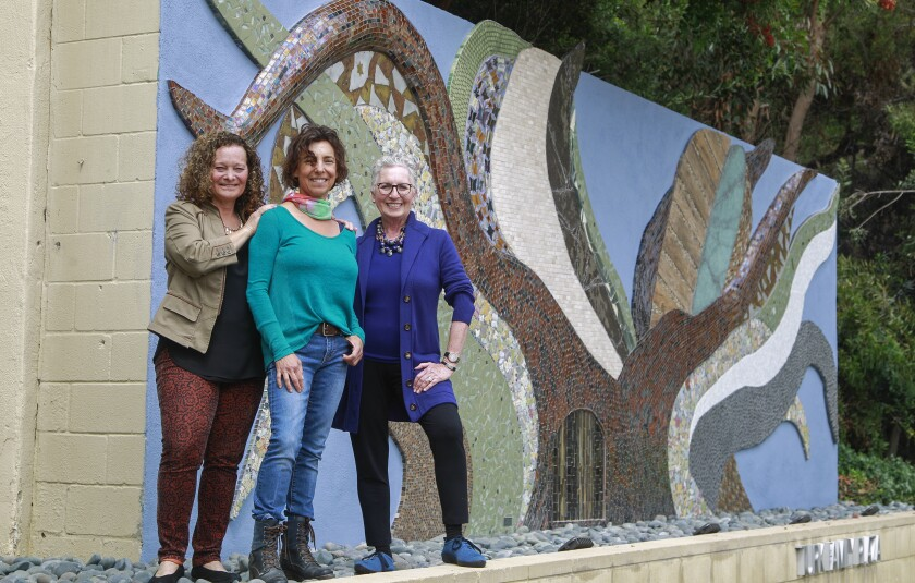 Cheryl Rattner Price, left, Helen Segal, and Sonia Ancoli Israel pose for photos at the new Holocaust memorial mural at Congregation Beth El in La Jolla.