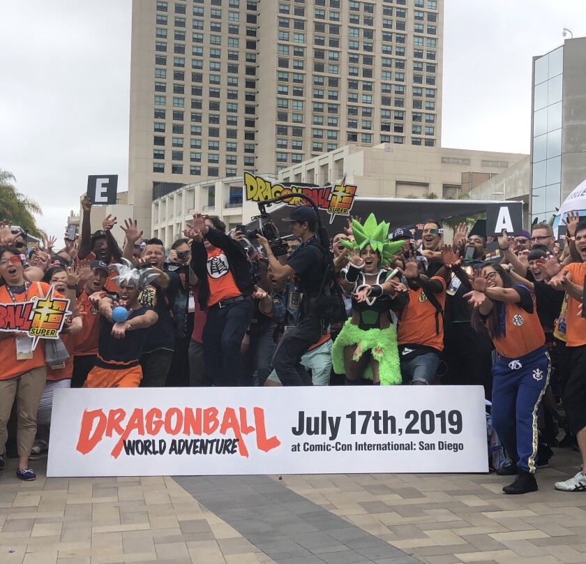 """""""Dragonball"""" enthusiasts practice performing the """"kamehameha"""" movement in unison to break a Guinness World Record on Comic-Con Preview Day."""