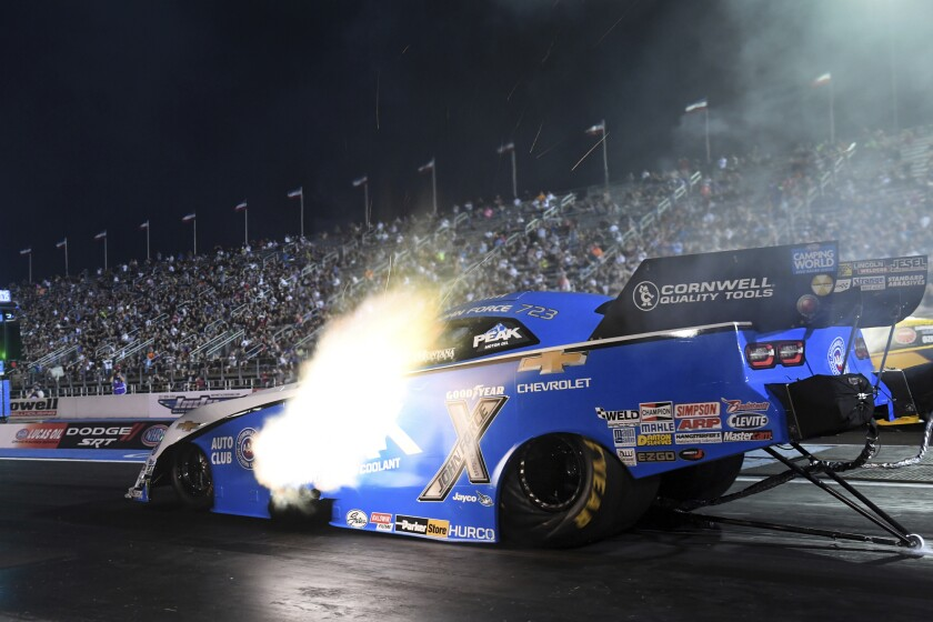 In this photo provided by the NHRA, John Force powers his Funny Car to kick off qualifying at the NHRA U.S. Nationals drag races at Lucas Oil Raceway in Brownsburg, Ind., Friday, Sept. 3, 2021. (Marc Gewertz/NHRA via AP)