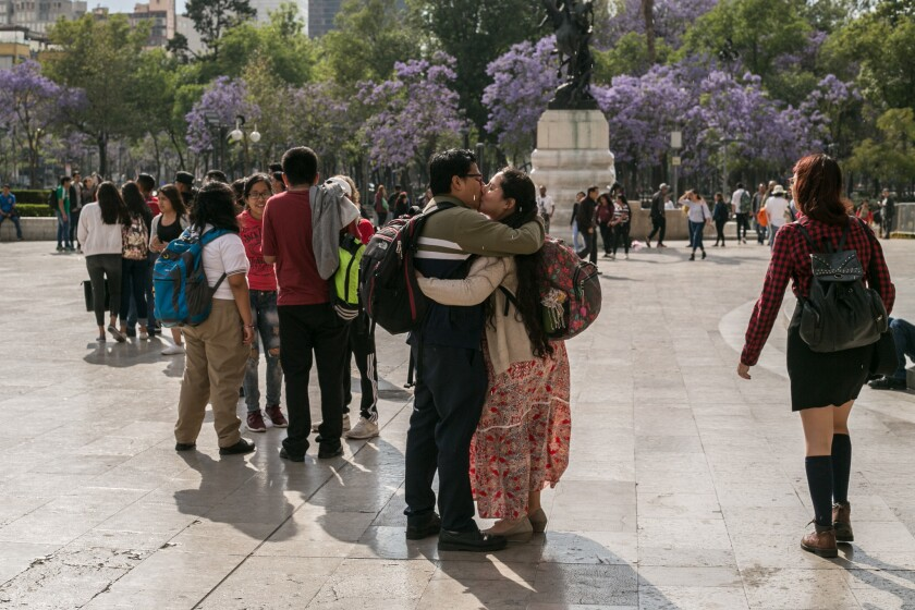 March 22, 2019 - Eduardo, 30 and Lili, 28, embrace in front of the Bellas Artes in Mexico City's Ala