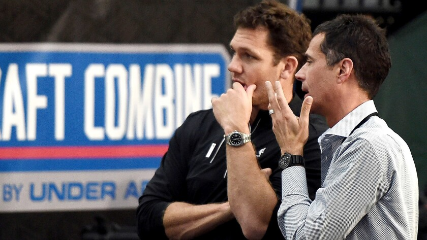 Lakers GM Rob Pelinka, right, chats with coach Luke Walton at the NBA draft combine on Friday at Quest MultiSport Complex in Chicago.