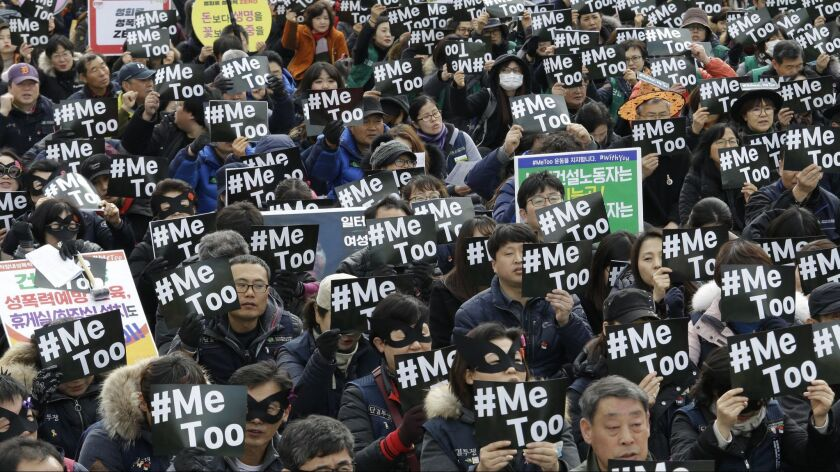 FILE - In this March 8, 2018, file photo, demonstrators supporting the #MeToo movement stage a rally