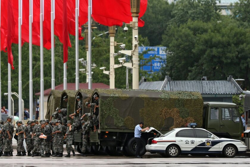 Chinese soldiers disembark from trucks Tiananmen Square in Beijing on Sept. 1 amid preparations for a major military parade.