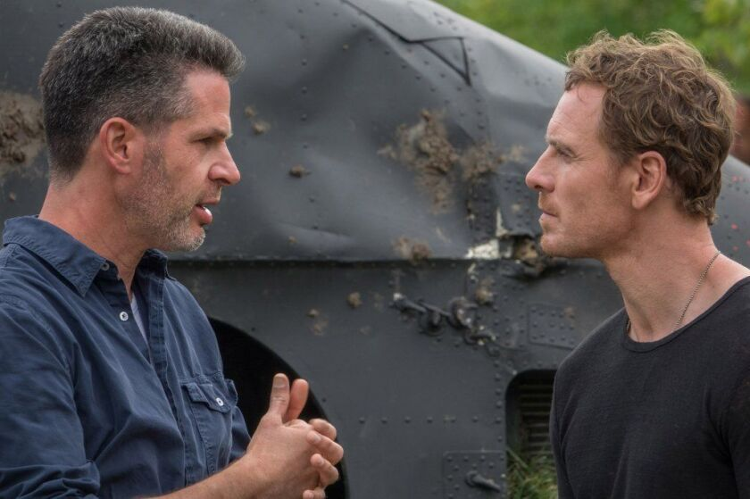 "Director Simon Kinberg, left, and Michael Fassbender on the set of ""Dark Phoenix."""