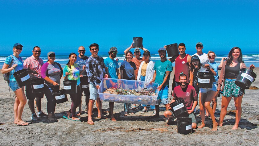 Some of the cleanup crew at Scripps Beach, April 13, 2019 with the plastic waste they collected to use for the 'Ocean Tunnel' art piece they hope will raise awareness of the issues harming marine ecosystems.