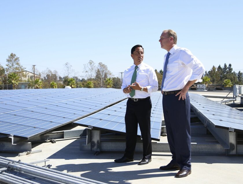 San Diego Mayor Kevin Faulconer and councilman Todd Gloria were part of a group that announced the city's draft Climate Action Plan in April 2014 atop the city's Alvarado Water Treatment Plant. / photo by Alejandro Tamayo * U-T