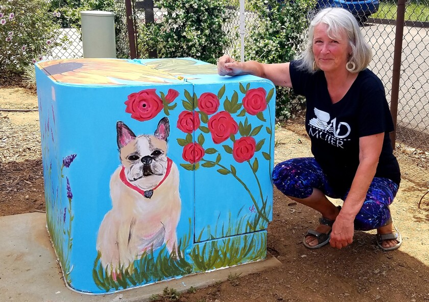 A friend commissioned artist Janice Reich to paint a 'quarantine mural' of her pet pug on her utility box.
