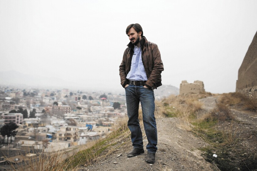 Author Graeme Smith on a hill by an old military fort in the Kululapushta district of Kabul, the capital of Afghanistan.