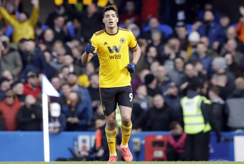 Wolverhampton Wanderers' Raul Jimenez celebrates after scoring his side's opening goal during the English Premier League soccer match between Chelsea and Wolverhampton Wanderers at Stamford Bridge stadium in London, Sunday, March 10, 2019.