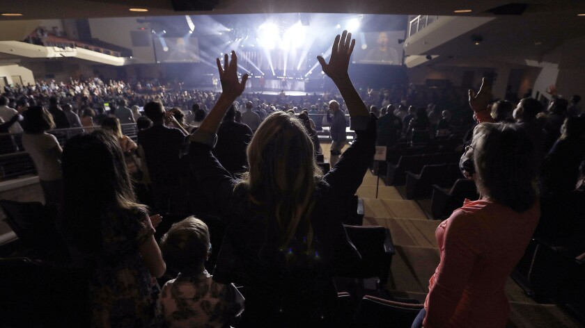 After more than a year without indoor services, Rock Church in Point Loma invited worshippers inside on April 18.