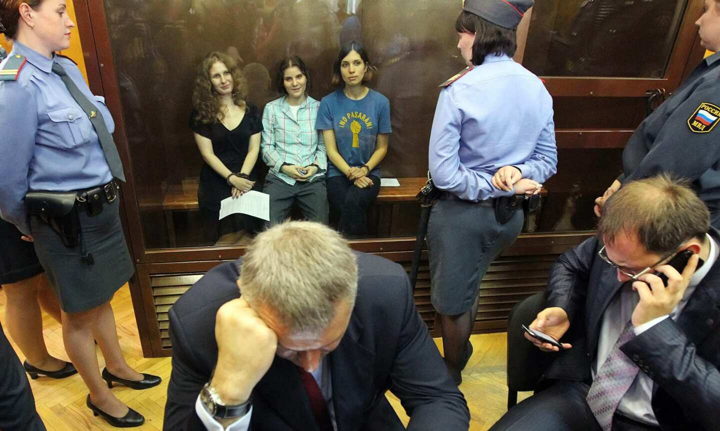 Russian feminist punk-rock band Pussy Riot members Maria Alyokhina, left, Yekaterina Samutsevich and Nadezhda Tolokonnikova sit in a glass-walled cage in a courtroom after the judge delivered the verdict at the Khamovnichesky Court in Moscow. Judge Marina Syrova sentenced the trio, who were found guilty of hooliganism motivated by religious hatred or hostility after singing a song insulting Vladimir Putin in the Christ the Savior Cathedral in Moscow earlier this year ahead of presidential elections in Russia, to two years in prison.
