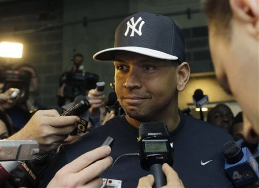 New York Yankees Alex Rodriguez, who is on the disabled list after hip surgery, talks to media outside the Yankees clubhouse before the Yankees Opening Day baseball game against the Boston Red Sox at Yankee Stadium in New York, Monday, April 1, 2013.  (AP Photo/Kathy Willens)