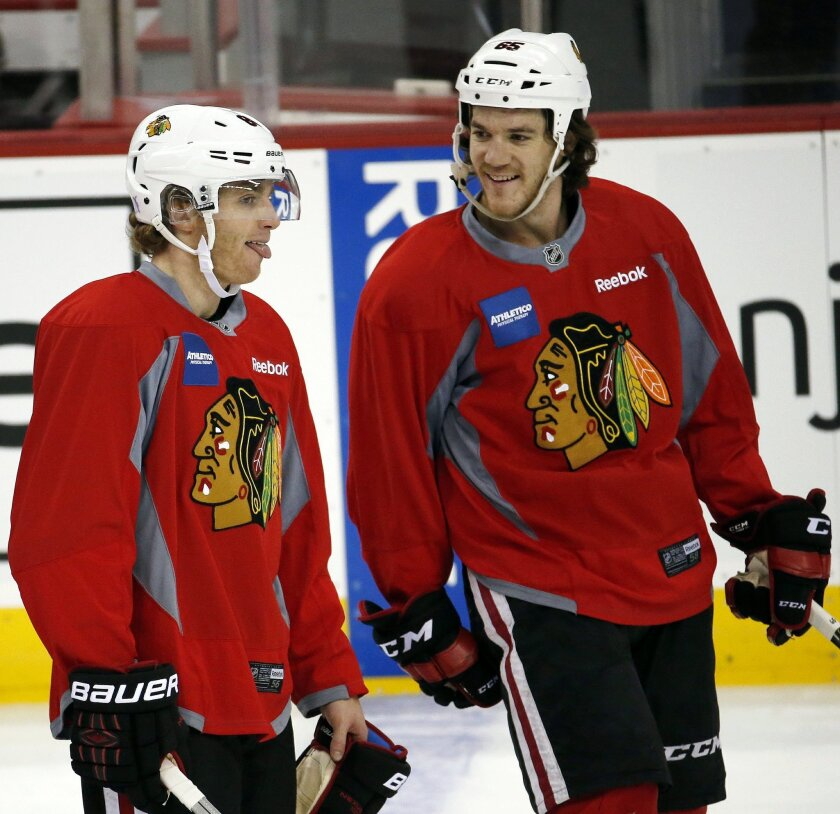 Chicago Blackhawks' Patrick Kane, left, talks to Andrew Shaw during a morning skate prior to facing the New Jersey Devils, Friday, Nov. 6, 2015, in Newark, N.J. Prosecutors announced Thursday, Nov. 5, 2015, that they will not bring rape charges against Kane, citing a lack of credible evidence and t