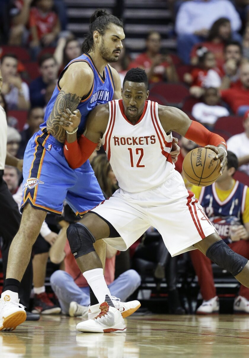 Houston Rockets' Dwight Howard (12) pushes against Oklahoma City Thunder's Steven Adams in the first half of an NBA basketball game Monday, Nov. 2, 2015, in Houston. (AP Photo/Pat Sullivan)