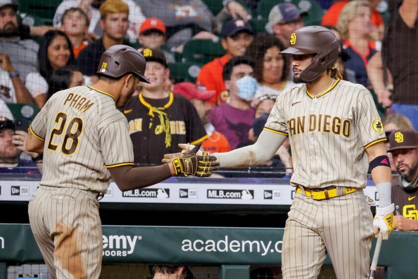 Fernando Tatis Jr. and Tommy Pham celebrate against the Astros