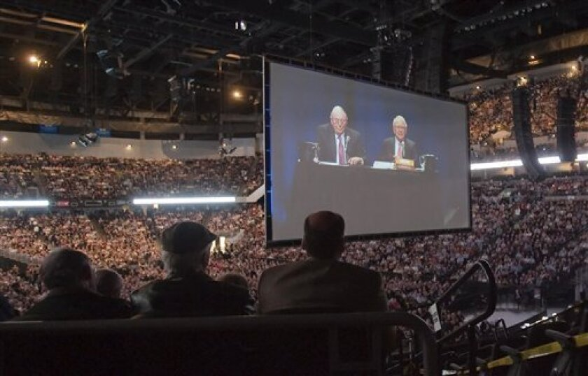 FILE - In this May 2, 2009 file photo, Warren Buffett, CEO of Berkshire Hathaway, right, and Charlie Munger, his vice chairman, are projected on a large screen at the annual Berkshire Hathaway shareholders meeting in Omaha, Neb. Berkshire Hathaway Inc. releases quarterly earnings report at the close of the market Friday, May 8, 2009. (AP Photo/Nati Harnik, file)