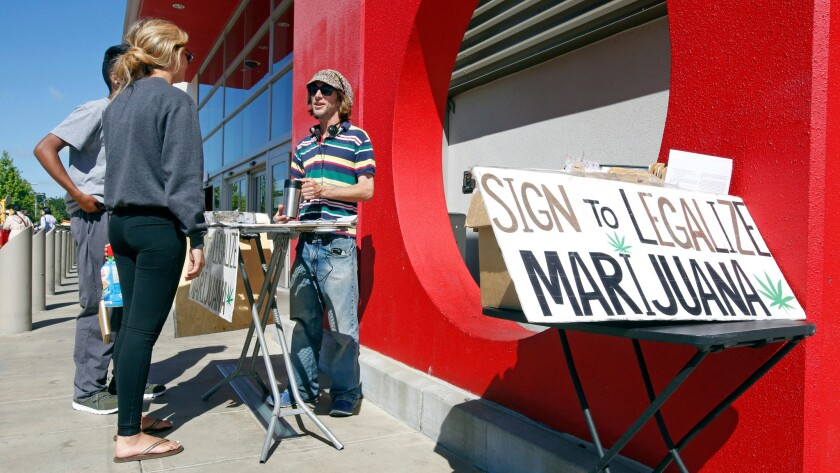 A signature gatherer discusses a petition to legalize marijuana in April. For the second time in six years, California voters are being asked to legalize the recreational use of marijuana.