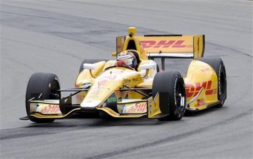 Ryan Hunter-Reay takes a corner during practice for the IndyCar auto race at Mid-Ohio Sports Car Course in Lexington, Ohio, Friday, Aug. 2, 2013. (AP Photo/Tom E. Puskar)