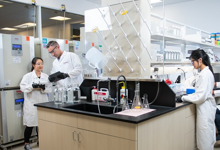 """Workers in a lab at Erasca, which is developing technologies to """"erase cancer"""""""