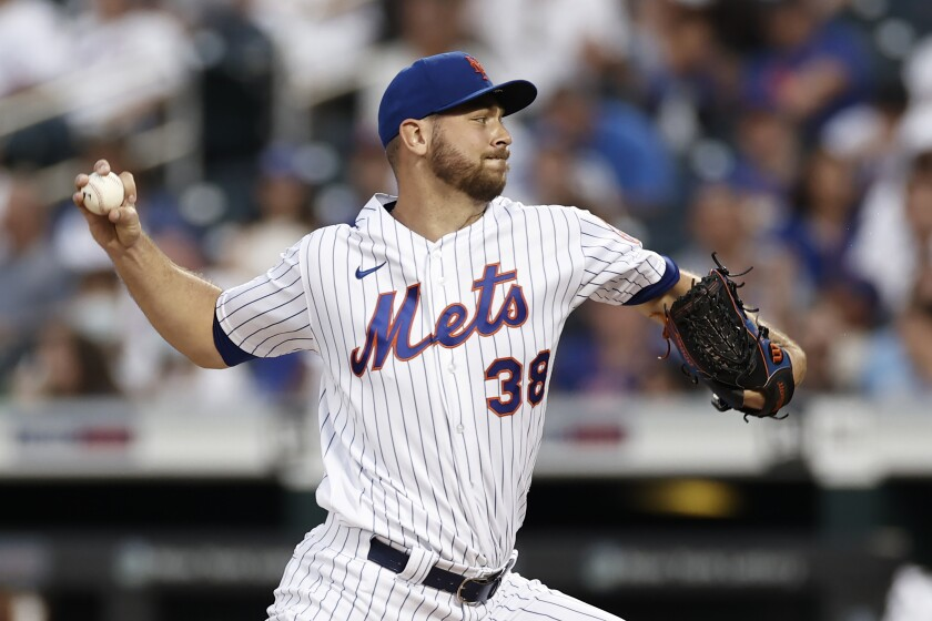 New York Mets pitcher Tylor Megill throws to a Toronto Blue Jays batter during the third inning of a baseball game Friday, July 23, 2021, in New York. (AP Photo/Adam Hunger)