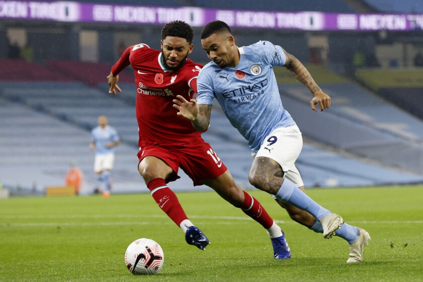 Liverpool's Joe Gomez vies for the ball with Manchester City's Gabriel Jesus, right, during the English Premier League soccer match between Manchester City and Liverpool at the Etihad stadium in Manchester, England, Sunday, Nov. 8, 2020. (Clive Brunskill/Pool via AP)