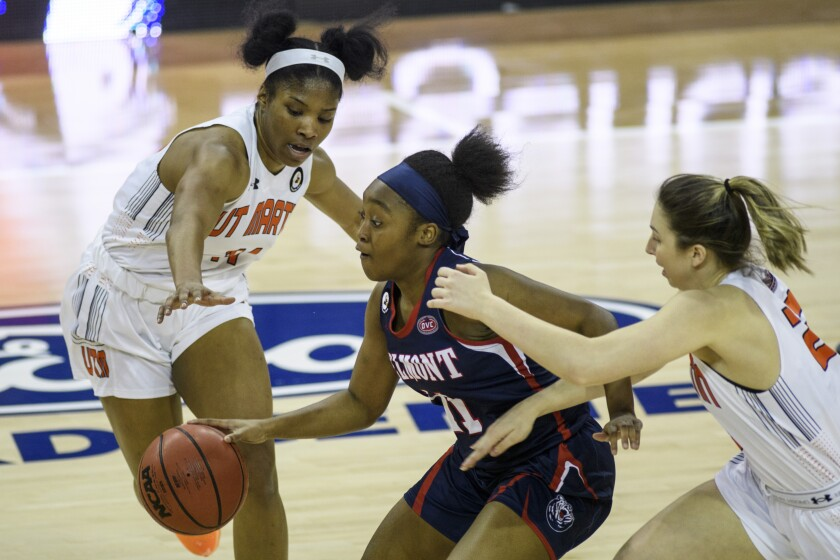 Belmont's Destinee Wells (11) drives through UT-Martin's Dasia Young (11) and Hayley Harrison (23) during an NCAA college basketball game in the championship of the Ohio Valley Conference tournament at the Ford Center in Evansville, Ind., Saturday, March 6, 2021. (Sam Owens/Evansville Courier & Press via AP)