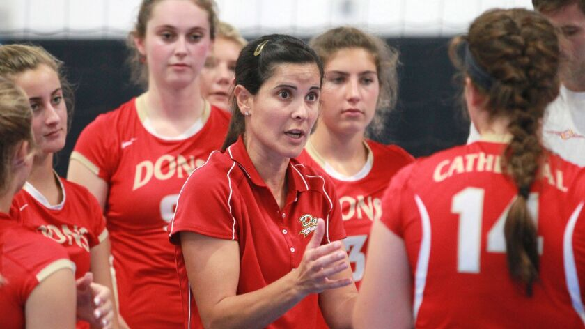 Cathedral Catholic coach Juliana Evens gives instructions during a timeout.