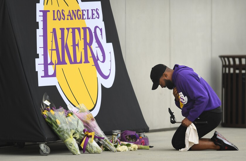 EL SEGUNDO, CALIFORNIA JANUARY 26, 2020-A Lakers fan sobs at a memorial for Kobe Bryant outside the Lakers practice facility Sunday. (Wally Skalij/Los Angeles Times)