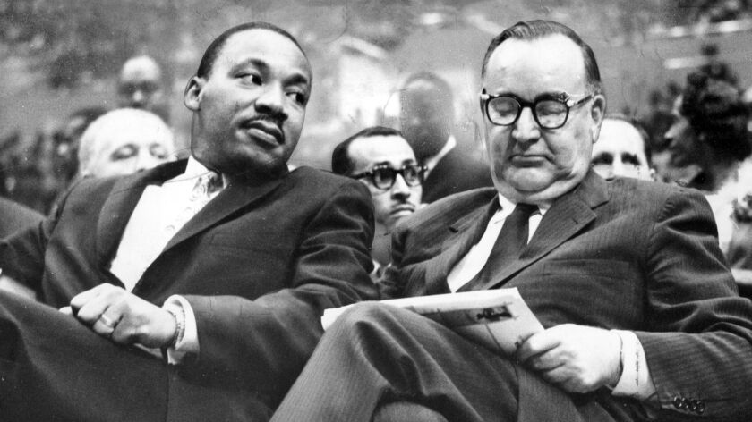 June 18, 1961: The Rev. Martin Luther King, Jr. sits with California Gov. Pat Brown at the Sports Ar
