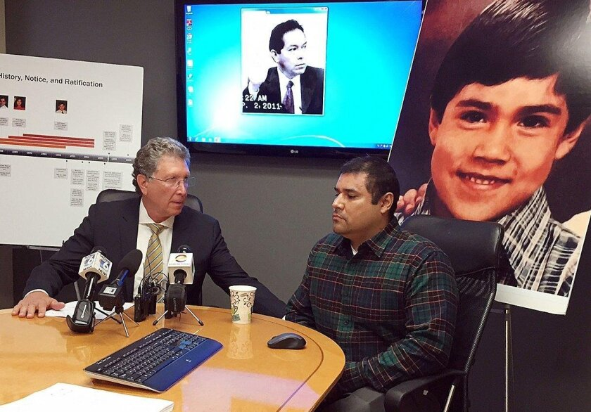 Lawyer Irwin Zalkin (left) and Jose Lopez speak in 2014 to the media about a $13.5 million judgment against the governing body of the Jehovah's Witness church. Lopez was a boy when a church leader molested him.