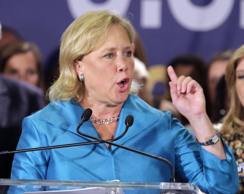 In this photo taken Nov. 4, 2014, Sen. Mary Landrieu, D-La., acknowledges supporters at her election night headquarters in New Orleans. Republicans have promised her Senate opponent Rep. Bill Cassidy a seat on the Senate's energy committee if he defeats Landrieu in the state's runoff election next