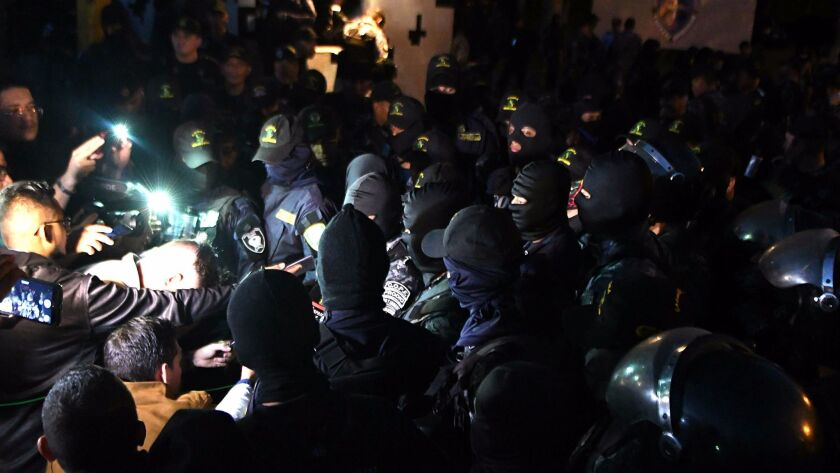 Riot police protest at their headquarters, where they are refusing to go out on the streets and crack down on demonstrators in Tegucigalpa on Dec. 4, 2017.