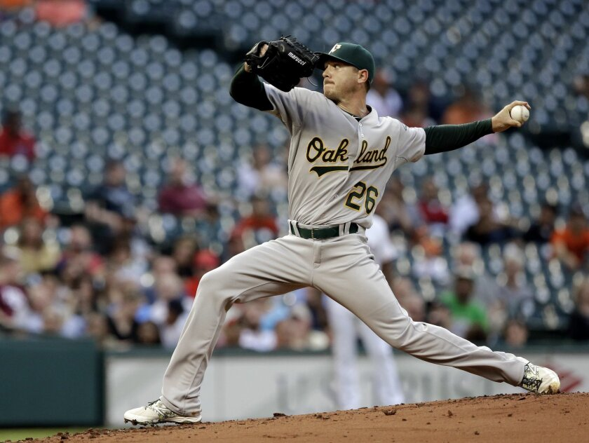 Oakland Athletics' Scott Kazmir delivers a pitch against the Houston Astros in the first inning of a baseball game Monday, April 13, 2015, in Houston. (AP Photo/Pat Sullivan)