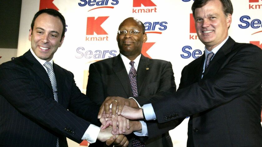 Edward Lampert, chairman of Kmart, left, Aylwin Lewis, president of Kmart, center, and Alan Lacy, C