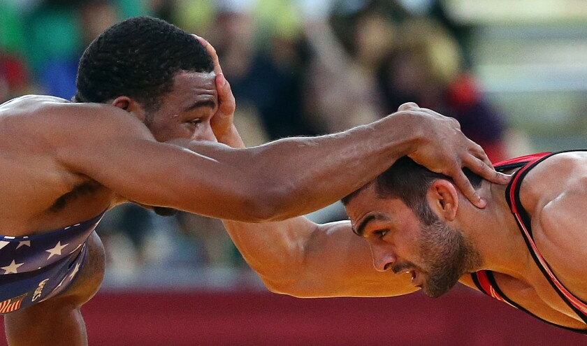 U.S. wrestler Jordan Burroughs, left, and Iran's Sadegh Saeed face off at the men's 74kg freestyle wrestling gold medal match at the London 2012 Olympics.