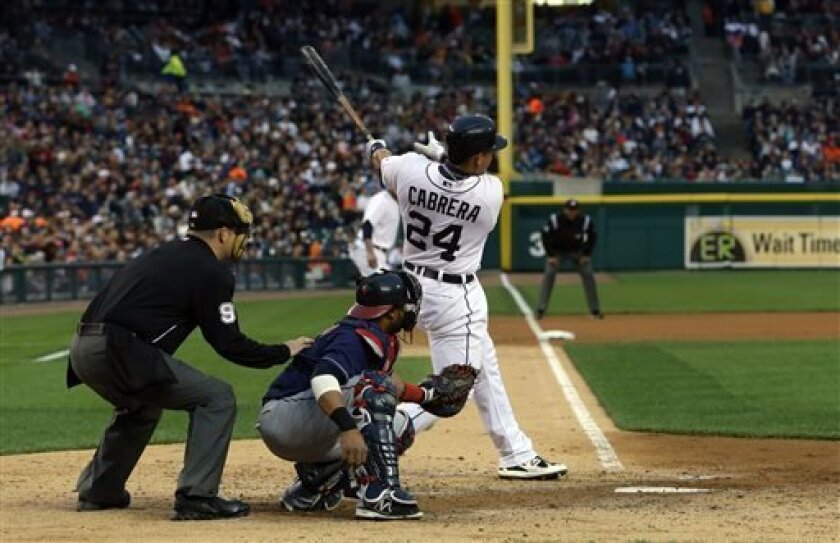 Detroit Tigers' Miguel Cabrera (24) connects for a three-run home run off Cleveland Indians starting pitcher Corey Kluber (not shown) during the fourth inning of a baseball game in Detroit, Friday, May 10, 2013. (AP Photo/Carlos Osorio)