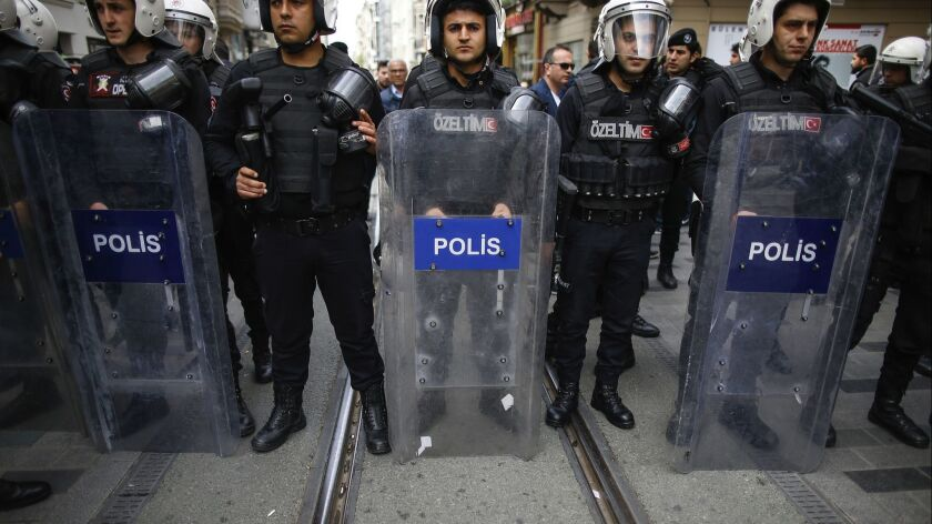 FILE - In this file photo dated Monday, April 16, 2018, Turkey's police officers look on as supporte